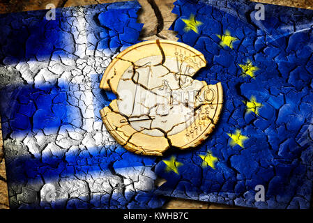 Euro-coin one with tears before Greece and EU flag, symbolic photo Grexit, Ein-Euro-Münze mit Rissen vor Griechenland - Stock Photo