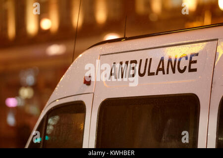 private ambulance waiting in city centre in the rain belfast northern ireland uk - Stock Photo