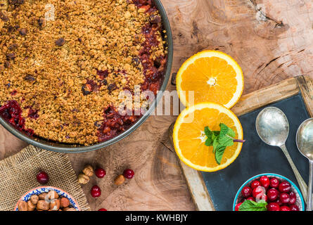 Cranberry, apple  and hazelnut crumble - top view - Stock Photo