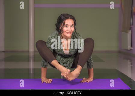 Female demonstrating yoga asana  - Stock Photo