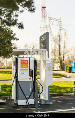 Sodetrel electronic vehicle charging station at a French motorway service station. - Stock Photo