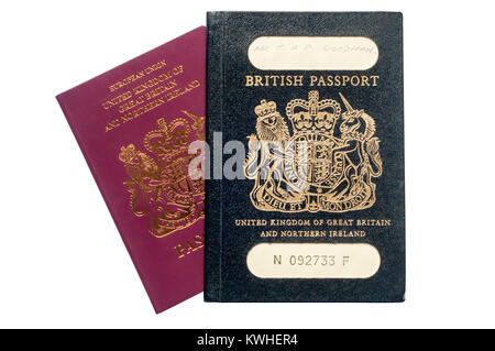 An old style black British passport issued in 1980s and a modern red British EU passport. - Stock Photo