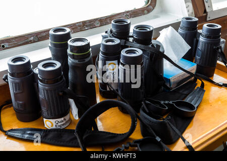 Binoculars used for navigation by ship's crew on bridge sailing passenger ship Ocean Adventurer; carries alpine - Stock Photo