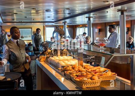 Dining room; passenger ship Ocean Adventurer carries alpine mountaineering skiers to Antarctica - Stock Photo