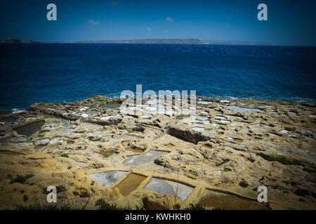 Gozo has a walking, hiking path around all of its coast giving stunning views out to sea, inland, and a view of - Stock Photo