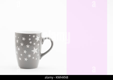 modern design decorated ceramic tea coffee mug on a white background - Stock Photo