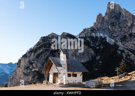 Small church at the Falzarego Pass on the Dolomites in northeastern Italy - Stock Photo