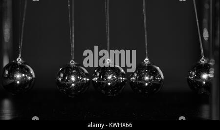 Newtons Cradele Pendulum Close Up. Conservation of Momentum. Exeter, Devon, UK. January, 2018. - Stock Photo
