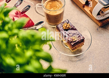 Sweet, delicious cake, herbs and cup of coffee - Stock Photo