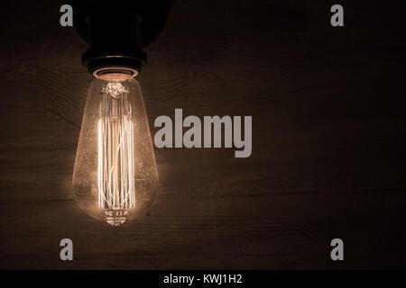 Vintage Bulb On Dark Background - Stock Photo
