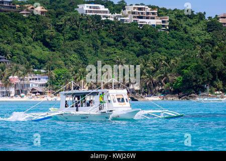 BORACAY ISLAND, PHILIPPINES - November 18, 2017 : Hopping, Dive boats in the Boracay sea - Stock Photo
