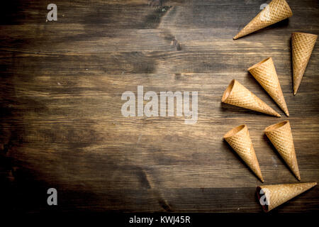 Waffle cups for ice cream. On a wooden table. - Stock Photo