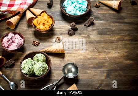 variety of fruit ice cream in bowls. On a wooden table. - Stock Photo