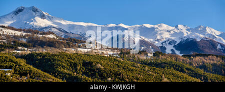 Winter panoramic view of the Saint-Sauveur village and the Les Orres sky resort in the background. Hautes-Alpes, - Stock Photo