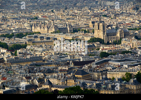 Aerial view on Paris rooftops at sunset with Notre Dame de Paris Cathedral. 4th (Latin Quarter) and 6th Arrondissment, - Stock Photo
