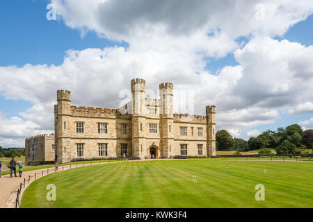 Main entrance facade to Leeds Castle, near Maidstone, Kent, southeast England, UK and croquet lawn on a sunny day - Stock Photo