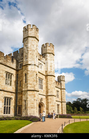 Main entrance to Leeds Castle, near Maidstone, Kent, southeast England, UK with towers and battlements on a sunny - Stock Photo