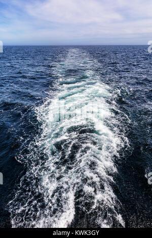 Stern view of wake; passenger ship Ocean Adventurer crossing Drake Passage; carries alpine mountaineering skiers - Stock Photo