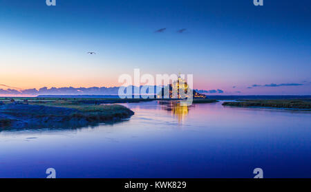 Panoramic view of famous Le Mont Saint-Michel tidal island in beautiful twilight during blue hour at dusk, Normandy, - Stock Photo