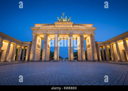 Classic view of famous Brandenburger Tor (Brandenburg Gate), one of the best-known landmarks and national symbols of Germany, in twilight during blue