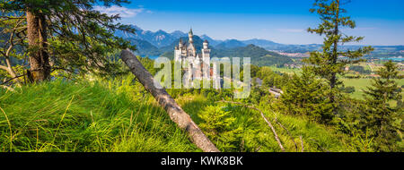 Beautiful view of world-famous Neuschwanstein Castle, the nineteenth-century Romanesque Revival palace built for - Stock Photo