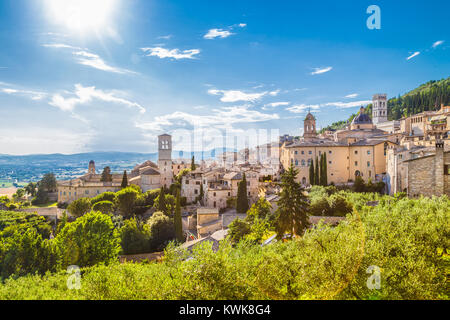 Panoramic view of the historic town of Assisi on a beautiful sunny day with blue sky and clouds in summer, Umbria, - Stock Photo