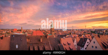 Panoramic view of the historic city of Nuremberg in beautiful golden evening light with dramatic clouds at sunset - Stock Photo