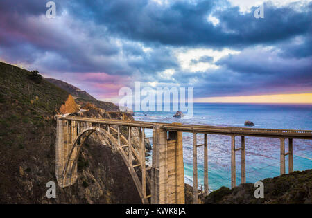 Scenic view of historic Bixby Creek Bridge along world famous Highway 1 in evening twilight, Big Sur, California, - Stock Photo