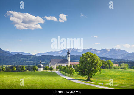 Classic view of famous Wilparting Pilgrimage Church with green meadows and trees on a sunny day in springtime, Irschenberg, - Stock Photo