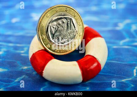Greek euro on life preserver, financial assistances for Greece, Griechischer Euro auf Rettungsring, Finanzhilfen - Stock Photo