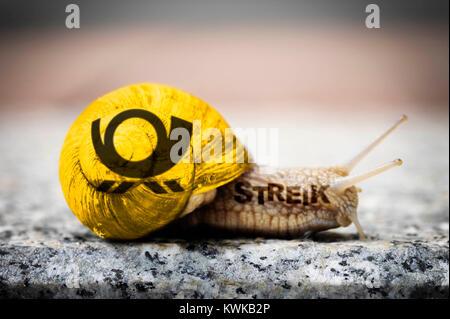 Snail with post horn, symbolic photo postal strike, Schnecke mit Posthorn, Symbolfoto Post-Streik - Stock Photo
