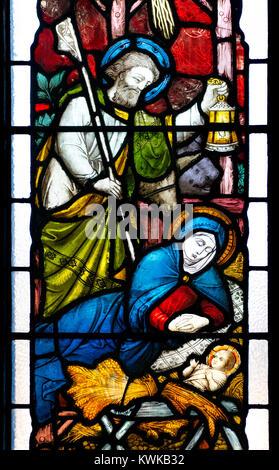 London, England, UK. St Mary Abbots parish church, Kensington. Stained glass window:  Joseph, Mary and Jesus in - Stock Photo