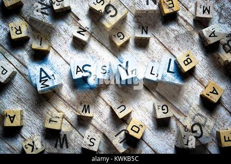 Letter cubes form the word Asylum, Buchstabenw?rfel formen das Wort Asyl - Stock Photo
