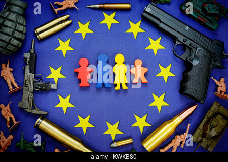 EU flag with figures of a family, surrounded by weapons, symbolic photo refugee's stream to Europe, EU-Fahne mit - Stock Photo