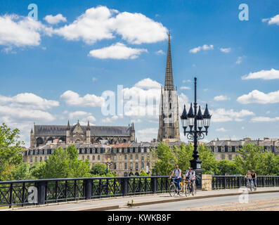 France, Gironde department, Bordeaux, Pont de Pierre (Pierre Bridge) over the Garonne River with view of Basilique - Stock Photo
