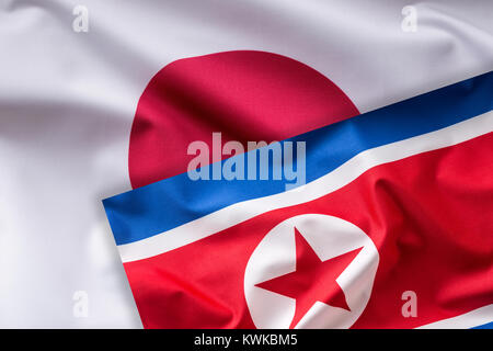 Japan and North Korea flag. Colorful Japan and  North Korea flag waving in the wind. - Stock Photo