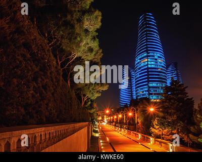 BAKU, AZERBAIJAN-DECEMBER 28, 2017: Baku street in the night with the Flame towers skyscrapers on it. - Stock Photo