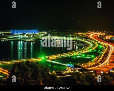 BAKU, AZERBAIJAN-DECEMBER 28, 2017: Panorama of the night Baku. View frome above on the Crystal Hall. - Stock Photo