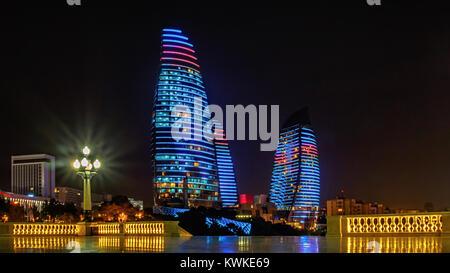 BAKU, AZERBAIJAN-DECEMBER 28, 2017: Flame towers skyscrapers in the night. - Stock Photo