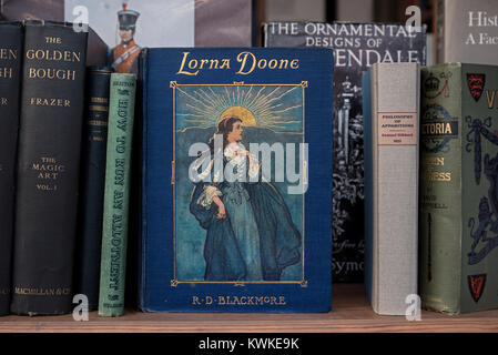 A vintage copy of Lorna Doone by R D Blackmorei the window of a secondhand bookshop in Edinburgh, Scotland, UK. - Stock Photo
