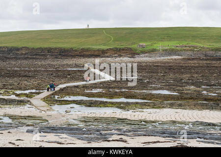 Causeway leading to the tidal island of Brough of Birsay, Mainland Orkney, Scotland, at low tide - Stock Photo