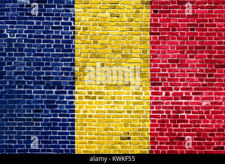 Flag of Chad painted on brick wall, background texture - Stock Photo