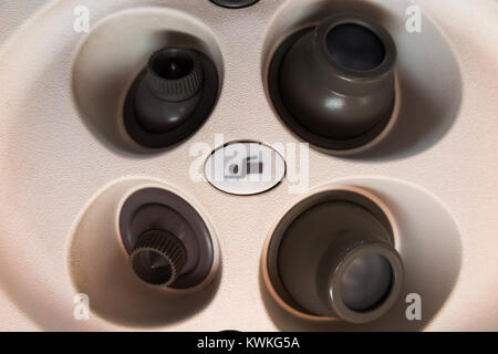 Flight attendant cabin crew call button & cool air nozzles / nozzle array above passenger seat in Embraer aeroplane - Stock Photo