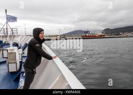 Crew member on deck of passenger ship Ocean Adventurer; departs Ushuaia; Argentina; enroute to Antarctica - Stock Photo