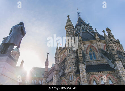 Low angle view of sculpture in front of church against sky during sunny day - Stock Photo