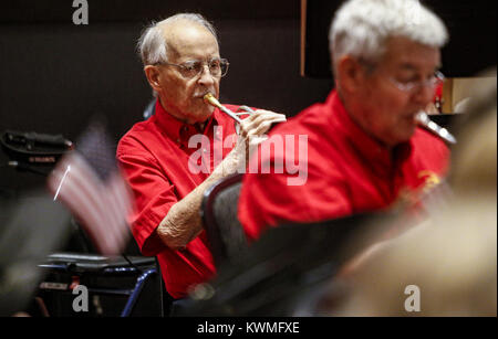 Davenport, Iowa, USA. 25th Aug, 2016. Trumpet player John Adams performs as a part of the CASI New Horizons Band - Stock Photo