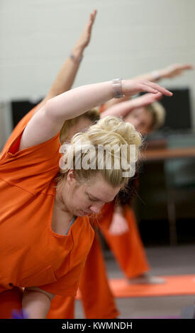 Davenport, Iowa, USA. 11th Oct, 2017. Scott County inmate Melinda Heyvaert stretches out in a yoga pose, Wednesday, - Stock Photo