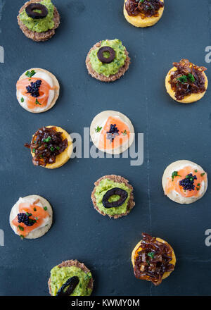canapes on dark grey slate - Stock Photo