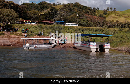 Boats ferrying passengers from La Fortuna land at Monteverde, across Lake Arenal, Costa Rica - Stock Photo
