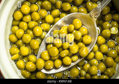 Marinated green peas with spoon in a bowl. - Stock Photo